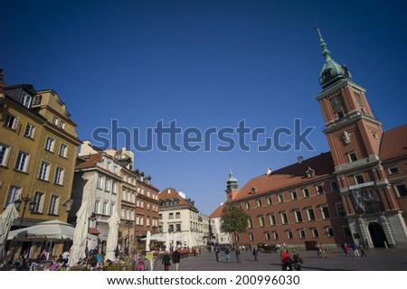 "WARSAW, POLAND - OCT 30: The Typical colored houses in the Real Castle square in the famous ""Stare Miastoa, quarter of the old city of Warsaw in Warsaw, Poland on October 30 2013."