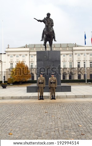 WARSAW, POLAND-OCT. 13: Unidentified armed forces guards stand in protection of The Presidential  Koniecpolski Palace in Warsaw Poland with  statue of Prince Jozef Poniatowski on October 13, 2013. - stock photo