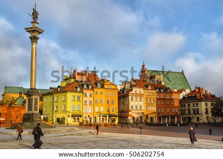 WARSAW, POLAND - OCTOBER 26, 2016 ; Beautiful Tenement houses in the morning sun on main Castle Square in Warsaw -the capital of Poland. The Royal Castle and Sigismund's Column called Kolumna Zygmunta