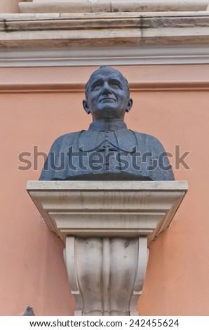 WARSAW, POLAND - OCTOBER 18, 2014: Bust of Pope John Paul II on the facade of Field Cathedral of the Polish Army in Warsaw, Poland. John Paul II visited the church on June 9, 1991 - stock photo