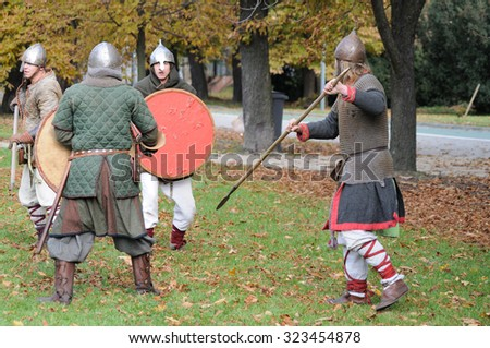 WARSAW, POLAND - OCTOBER 16, 2010: Fights and weapons show of ancient Slavic warriors - historical reenactment of the tenth century - Slavic Autumn in the Agrykola park. - stock photo