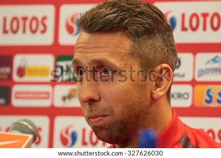 WARSAW, POLAND - OCTOBER 10, 2015: Jakub Wawrzyniak (Poland) during press conference before EURO 2016 qualification football match beetween Poland and Republic of Ireland. - stock photo