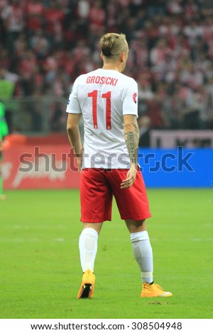 WARSAW, POLAND - OCTOBER 11, 2014: Kamil Grosicki (Polish team and French club Stade Rennais winger) during the UEFA EURO 2016 qualifying match of Poland vs. Germany.  - stock photo