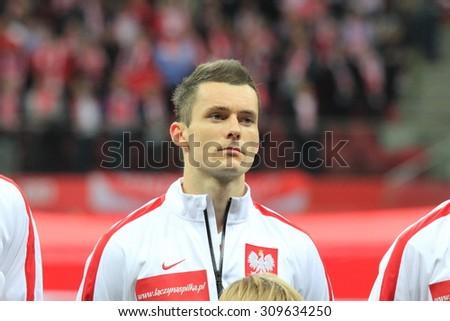 WARSAW, POLAND - OCTOBER 14, 2014: Krzysztof Maczynski (Polish team and Wisla Krakow club midfielder) before the UEFA EURO 2016 qualifying match of Poland vs. Scotland. - stock photo
