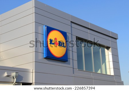 WARSAW, POLAND - OCTOBER 29, 2014: Lidl logo. Lidl is a German global discount supermarket chain. Lidl in Poland today has more than 500 stores. - stock photo