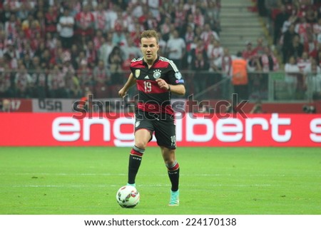WARSAW, POLAND - OCTOBER 11, 2014: Mario Gotze (German and Bayern Munich player) during the UEFA EURO 2016 qualifying match of Poland vs. Germany. Poland beat Germany 2:0 - stock photo