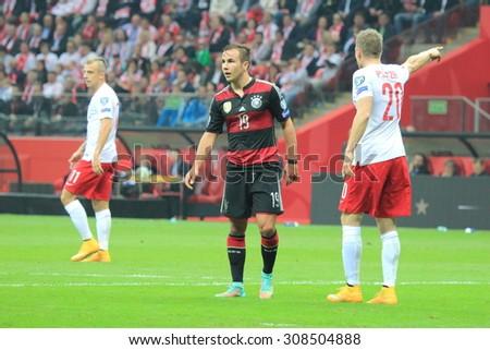 WARSAW, POLAND - OCTOBER 11, 2014: Mario Gotze (German team and Bundesliga club Bayern Munich striker) in action during the UEFA EURO 2016 qualifying match of Poland vs. Germany.  - stock photo