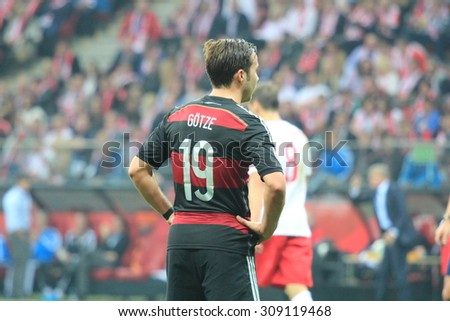 WARSAW, POLAND - OCTOBER 11, 2014: Mario Gotze (German team and Bundesliga club Bayern Munich player) in action during the UEFA EURO 2016 qualifying match of Poland vs. Germany.  - stock photo