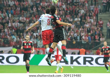 WARSAW, POLAND - OCTOBER 11, 2014: Robert Lewandowski (Polish team and Bundesliga club Bayern Munich striker) fights for the ball during the UEFA EURO 2016 qualifying match of Poland vs. Germany.  - stock photo