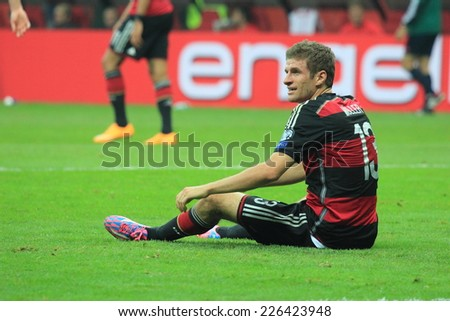 WARSAW, POLAND - OCTOBER 11, 2014: Thomas Muller in action (German team and Bundesliga club Bayern Munich player) during the UEFA EURO 2016 qualifying match of Poland vs. Germany - stock photo