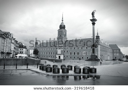 Warsaw, Poland. Old Town - famous Royal Castle at Plac Zamkowy square. UNESCO World Heritage Site. Rainy weather. Black and white style. - stock photo
