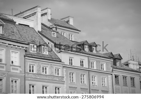 Warsaw, Poland. Old Town - townhouses at the main square. UNESCO World Heritage Site. Black and white tone - retro monochrome color style. - stock photo