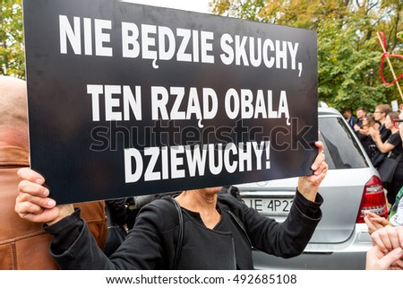 "Warsaw, Poland, 2016 10 01 - protest against anti-abortion law forced by Polish government; woman with banner saying: ""there will be no miss, this government overthrow girls"""