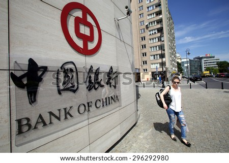 WARSAW, POLAND - SATURDAY, JUNE 6, 2015: A pedestrian walks past the offices of the Bank of China in Warsaw. Bank of China Limited is one of the 5 biggest state-owned commercial banks in China.   - stock photo