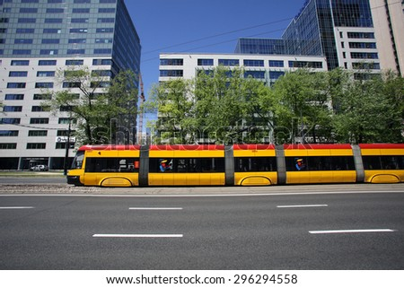 WARSAW, POLAND - SATURDAY, JUNE 6, 2015: A tram, or lightrail, in Warsaw, owned and operated by ZTM.   - stock photo