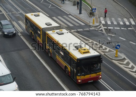 Warsaw Poland - Sep. 10 2017 -  Bus is very useful public transportation in Warsaw, capital of Poland. It is painted Yellow and red.