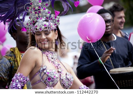WARSAW, POLAND, SEPT 8: Unidentified Carnival dancers on the XV Pink Ribbon Walk against the Breast Cancer september 8, 2012 in Warsaw, Poland.