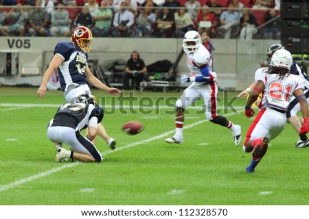 WARSAW, POLAND - SEPTEMBER 1: American football player, Europe team member Ola Kimrin (K) from Sweden kicks the football during Euro-American Challenge match on September 1, 2012 in Warsaw, Poland.