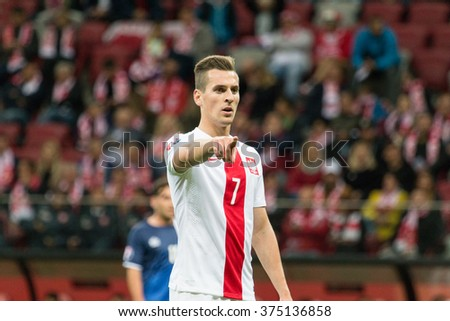 WARSAW, POLAND - SEPTEMBER 7, 2015: Arkadiusz Milik (Poland) during the EURO 2016 qualification match between Poland and Gibraltar at the National Stadium on September 7, 2015 in Warsaw, Poland.  - stock photo