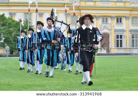 WARSAW, POLAND - SEPTEMBER 11, 2010: Brotherhood of Knights Nowa Deba presents a show drill of Musketeers, during of the Wilanow Days event. - stock photo