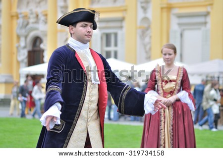 WARSAW, POLAND - SEPTEMBER 11, 2010: Dancers of the ensemble Gratia Iuvenis shows the historical Court dances, during of the Wilanow Days event. - stock photo
