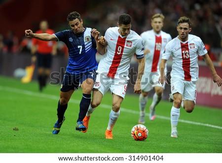 WARSAW, POLAND - SEPTEMBER 07 , 2015: EURO 2016 EURO France Football Cup Qualifiers Poland vs Gibraltaro/p Lee Casciaro Robert Lewandowski  - stock photo