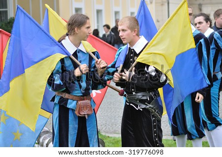 WARSAW, POLAND - SEPTEMBER 11, 2010: Flag-wavers Brotherhood of the Knights New Deba, before the start of the art show juggling flags, during of the Wilanow Days event. - stock photo