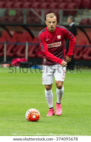 WARSAW, POLAND - SEPTEMBER 7, 2015: Kamil Grosicki (Poland) before the EURO 2016 qualification match between Poland and Gibraltar at the National Stadium on September 7, 2015 in Warsaw, Poland.  - stock photo