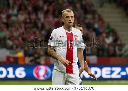 WARSAW, POLAND - SEPTEMBER 7, 2015: Kamil Grosicki (Poland) during the EURO 2016 qualification match between Poland and Gibraltar at the National Stadium on September 7, 2015 in Warsaw, Poland.  - stock photo