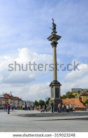 WARSAW, POLAND - SEPTEMBER 16, 2015: Tourists from all over visit the old city with a column of Sigismund on 16 September 2015 in Warsaw, Poland.