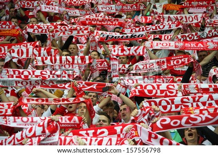 WARSAW, POLAND - SEPTEMBER 6: Unidentified Polish football fans the 2014 World Cup qualification football match between Poland and Montenegro on September 6, 2013 in Warsaw, Poland.  - stock photo