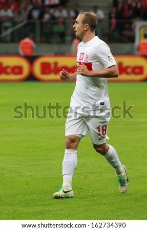 WARSAW - SEPTEMBER 6: Adrian Mierzejewski (Poland) during the 2014 World Cup qualification match between Poland and Montenegro at the National Stadium on September 6, 2013 in Warsaw, Poland.  - stock photo