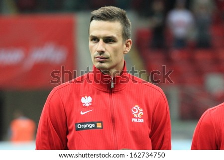 WARSAW - SEPTEMBER 6: Lukasz Szukala (Poland) before the 2014 World Cup qualification match between Poland and Montenegro at the National Stadium on September 6, 2013 in Warsaw, Poland.  - stock photo