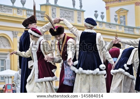 WARSAW - SEPTEMBER 11: Polish old-time national dance, performed by the ensemble Kuznia Artystyczna, during of the Wilanow Days event on September 11, 2010 in Warsaw, Poland. - stock photo