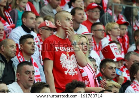 WARSAW - SEPTEMBER 6: Unidentified supporters during the 2014 FIFA World Cup qualification match between Poland and Montenegro at the National Stadium on September 6, 2013 in Warsaw, Poland.  - stock photo