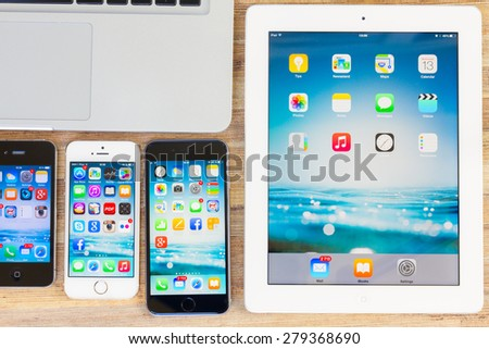 WARSZAWA, POLAND - MAY , 2015. Apple Ipad 2 with set of Iphones   6, 5s and 4  on macbook.  - stock photo