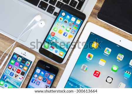 WARSZAWA, POLAND - MAY 13, 2015. Apple new Iphones 6    on macbook keyboard with ipad, iphone 5s and 4s - stock photo