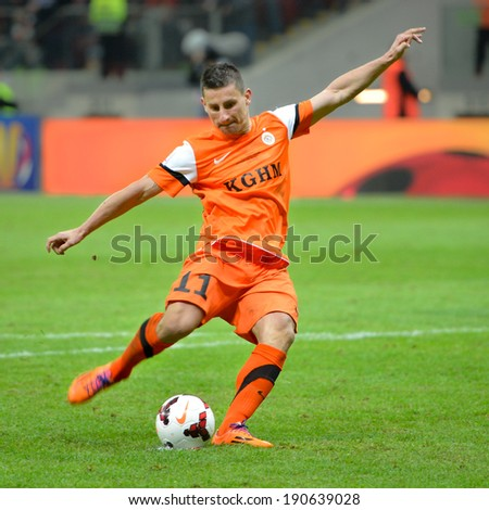 WARSZAWA, POLAND - MAY 02, 2014: Arkadiusz Piech is shotting  penalty kick during Polish Cup Final between Zawisza Bydgoszcz - KGHM Zaglebie Lubin 6:5 (0:0). - stock photo
