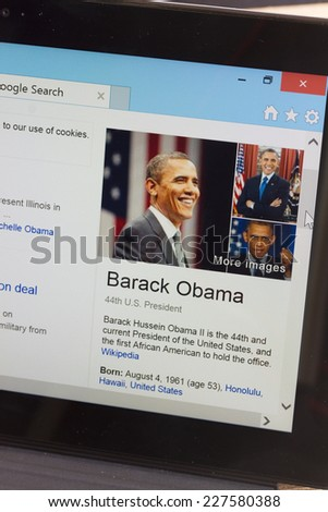 WARSZAWA, POLAND - OCTOBER 10, 2014.  Barack Obama WiKi page on screen of tablet.  - stock photo