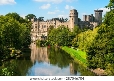 Warwick castle from outside. It is a medieval castle built in 11th century and a major touristic attraction in UK nowadays. Sunny day - stock photo