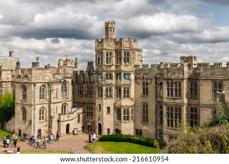WARWICK, UK - AUGUST 5:  View of Warwick castle  on August 5, 2014 in Warwick. Warwick Castle  is a medieval castle developed from an original built by William the Conqueror in 1068. - stock photo
