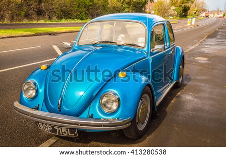 Warwickshire, United Kingdom - April 7, 2016: Blue classic car Volkswagen Beetle parked at the street as seen from the front. - stock photo