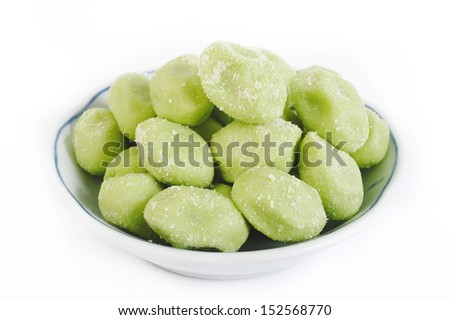 wasabi coated pistachios  in bowl