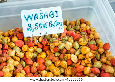 wasabi crispy peanut on a traditional market stall - stock photo