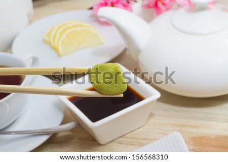 Wasabi in bamboo sticks with soy sauce  - stock photo