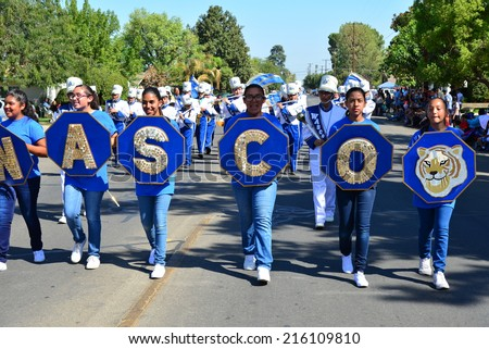 WASCO, CA - SEPTEMBER 6, 2014: The Thomas Jefferson Middle School Cougars marching band struts its stuff as part of the parade during the annual Festival of Roses.  - stock photo