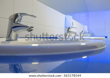 Wash basin in the toilet - stock photo