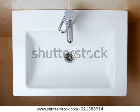wash sink in a bathroom, top view - stock photo