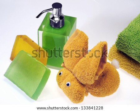 wash skin with colored soap dispenser and towels - stock photo