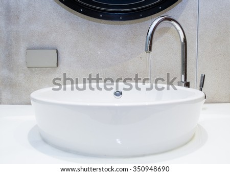 washbasin and faucet with water drop at home - stock photo